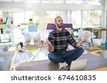 male executive doing yoga on... | Shutterstock . vector #674610835
