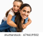 mother giving her daughter a... | Shutterstock . vector #674619502