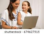 mom teaching daughter working... | Shutterstock . vector #674627515