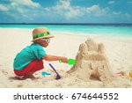 little boy building sand castle ... | Shutterstock . vector #674644552