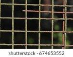 old weather beaten metal fence   Shutterstock . vector #674653552