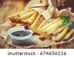 churros cooked in the oven with ... | Shutterstock . vector #674656216