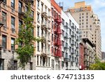 block of colorful old apartment ...   Shutterstock . vector #674713135