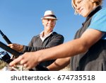 senior man fishing with his... | Shutterstock . vector #674735518