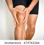 asian man holds on to the knee  ... | Shutterstock . vector #674762266