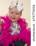 a baby girl with a funny... | Shutterstock . vector #674773426