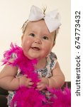 a baby girl with a smile ... | Shutterstock . vector #674773432