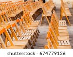 rows of chairs from side | Shutterstock . vector #674779126