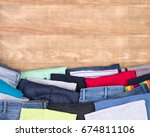 clothes donations on wooden... | Shutterstock . vector #674811106