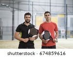 paddle tennis couple ready for... | Shutterstock . vector #674859616