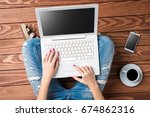 woman using modern laptop while ... | Shutterstock . vector #674862316