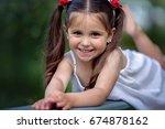 cute little smiling girl... | Shutterstock . vector #674878162