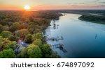 intracoastal cut sunset  ...   Shutterstock . vector #674897092