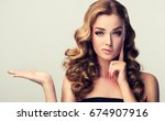 frowning  woman  disbelief... | Shutterstock . vector #674907916
