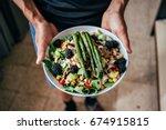 man hands holding big deep... | Shutterstock . vector #674915815