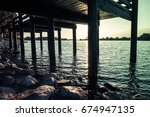 under the bridge by the lake | Shutterstock . vector #674947135