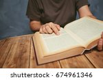 senior woman reading a book at... | Shutterstock . vector #674961346