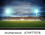 stadium in lights and flashes... | Shutterstock . vector #674977078