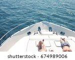 young couple sunbathing on... | Shutterstock . vector #674989006