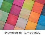 Small photo of Spectrum of multi colored wooden blocks aligned. Background or cover for something creative or diverse. Transparent colors.