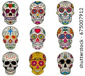 set of sugar skulls isolated on ... | Shutterstock .eps vector #675007912