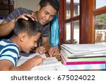 asian adult teach homework... | Shutterstock . vector #675024022