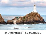 corbiere lighthouse in jersey ... | Shutterstock . vector #675028312