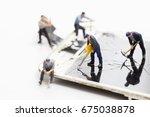 technician miniature fixing ... | Shutterstock . vector #675038878