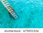 wood stair into the sea of... | Shutterstock . vector #675051526