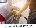 grey car at gas station being... | Shutterstock . vector #675055195