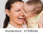nice mother stands and holds... | Shutterstock . vector #67508266