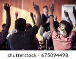raised hands and arms of large... | Shutterstock . vector #675094498