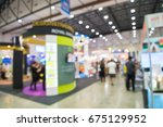 Small photo of Abstract blur people in exhibition hall event trade show background