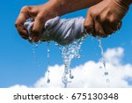 squeezing of wet cloth against... | Shutterstock . vector #675130348