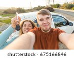 young funny couple with keys to ... | Shutterstock . vector #675166846
