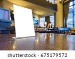 mock up menu frame on table in... | Shutterstock . vector #675179572