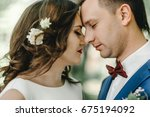 bride and groom on their... | Shutterstock . vector #675194092