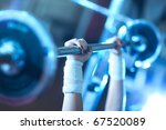 Young woman weight training. Focus on hand. - stock photo