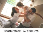 happy family with one daughter... | Shutterstock . vector #675201295