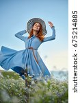 woman in the field  hat ... | Shutterstock . vector #675214885