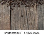 coffee beans on grunge vintage... | Shutterstock . vector #675216028