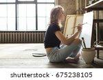 female artist working on... | Shutterstock . vector #675238105