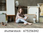 female artist sitting and... | Shutterstock . vector #675256342