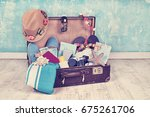 vintage suitcase with travel... | Shutterstock . vector #675261706