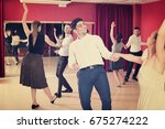 young smiling people practicing ... | Shutterstock . vector #675274222