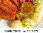 deep fried pork knuckle with... | Shutterstock . vector #675276592