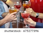 drink a cocktail   toast  ... | Shutterstock . vector #675277396