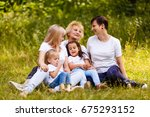 happy grandmother with two... | Shutterstock . vector #675293152