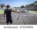 Small photo of Vallelunga, Rome, Italy. June 24 2017. Italian Super Cup cars positioning on starting grid, mechaninc point out position to Bmw car