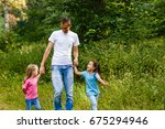 young father and his little... | Shutterstock . vector #675294946